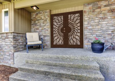 House entrance porch with stone wall trim